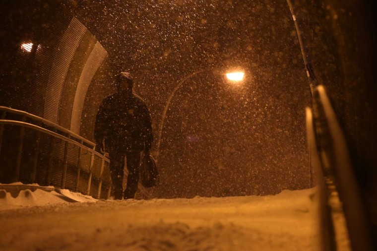 A man walks along a bridge in Brooklyn during a snow storm on January 21, 2014 in New York City. New York City is expected to receive up to 10 inches of snow, with blizzard like conditions, before the storm ends some time in the early hours of Wednesday. (Spencer Platt/Getty Images)
