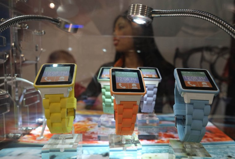 A hostess presents the Burg phone watch during the 2014 International CES at the Las Vegas Convention Center in Las Vegas, Nevada. CES, the world's largest annual consumer technology trade show, runs through January 10 and is expected to feature 3,200 exhibitors showing off their latest products and services to about 150,000 attendees. (Joe Klamar/Getty Images)