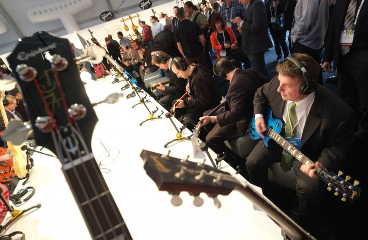 Visitors check Gibson's guitars during the 2014 International CES at the Las Vegas Convention Center in Las Vegas, Nevada. CES, the world's largest annual consumer technology trade show, runs through January 10 and is expected to feature 3,200 exhibitors showing off their latest products and services to about 150,000 attendees. (Joe Klamar/Getty Images)