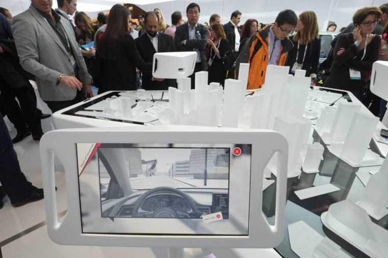 Visitors check Audi's Concept Vision of Tomorrow during the 2014 International CES at the Las Vegas Convention Center in Las Vegas, Nevada. CES, the world's largest annual consumer technology trade show, runs through January 10 and is expected to feature 3,200 exhibitors showing off their latest products and services to about 150,000 attendees. (Joe Klamar/Getty Images)