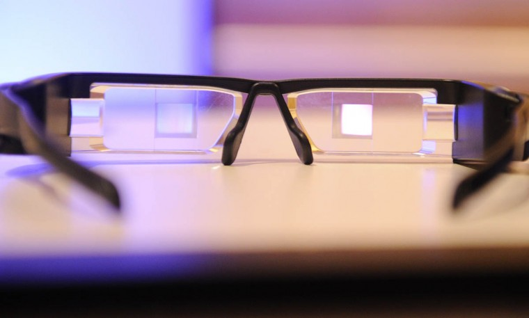 The Epson Moverio BT-200 smart glasses are seen at the 2014 International CES in Las Vegas, Nevada. The Moverio BT-200 projects two identical 16:9 images onto the lens-based screens, generating a semi-transparent picture to fall within the user's field of vision. The Android 4.0-based headset with portable controller features a front-facing camera and motion sensors for Augmented Reality and gaming. The glasses can be pre-ordered in the US now for USD $699 and are expected to ship in the spring. (Robyn Beck/Getty Images)