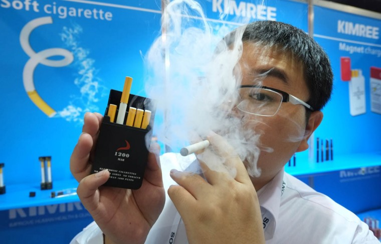 Bin Zhou of Kimree shows electronic cigarettes at the Kimree booth during the 2014 International CES at the Las Vegas Convention Center in Las Vegas, Nevada. CES, the world's largest annual consumer technology trade show, runs through January 10 and is expected to feature 3,200 exhibitors showing off their latest products and services to about 150,000 attendees. (Joe Klamar/Getty Images)