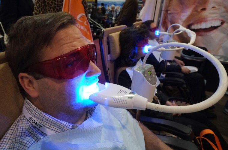 A visitor get his teeth whitened at the Teeth Bright booth during the 2014 International CES at the Las Vegas Convention Center in Las Vegas, Nevada. CES, the world's largest annual consumer technology trade show, runs through January 10 and is expected to feature 3,200 exhibitors showing off their latest products and services to about 150,000 attendees. (Joe Klamar/Getty Images)