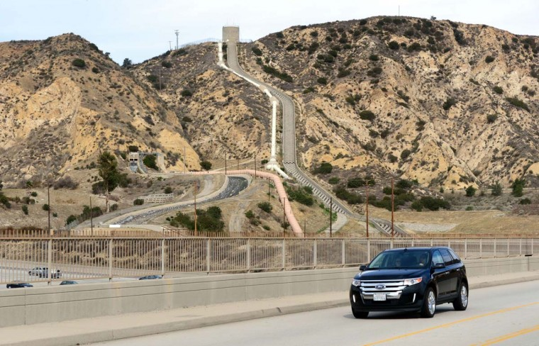 A vehicle crosses an overpass near the Los Angeles Aqueduct, nestled amid a dry and barren hillside in Sylmar, California, north of Los Angeles. The Aqueduct first opened 100 years ago and in 1913 it began bringing water from the Owens River on the eastern slope of the Sierra Mountains to Los Angeles, beginning the transformation and rapid expansion of the southern California city from a sleepy agricultural town into a modern metropolis. California is suffering its third dry winter in a row and is now in a state of emergency, as declared by Governor Jerry Brown on January 17, due to what could be the western US state's worst drought in a century, sparking wildfires and hurting farmers and Brown has urged state residents to reduce their water use by at least 20 percent. (Frederic J. Brown/Getty Images)