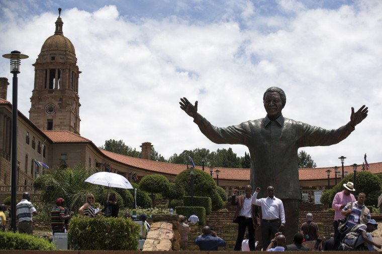 A statue of former South African president Nelson Mandela is unveiled at the Union Buildings on December 16, 2013 in Pretoria, South Africa. South African president Jacob Zuma unveiled a 9 meter bronze statue of former South African president Nelson Mandela as part of the Day of Reconciliation celebrations. (Photo by Oli Scarff/Getty Images)