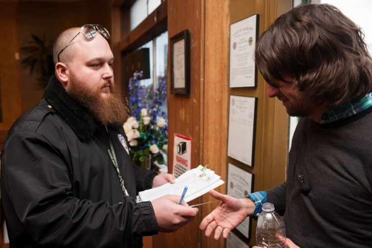 Head of security Kurt Britz, left, checks the driver's license of Adam Hartle of Jacksonville, Fla., at the 3-D Denver Discrete Dispensary on Jan. 1, 2014 in Denver, Colo. Legalization of recreational marijuana sales in the state went into effect at 8 a.m. (Theo Stroomer/Getty Images)