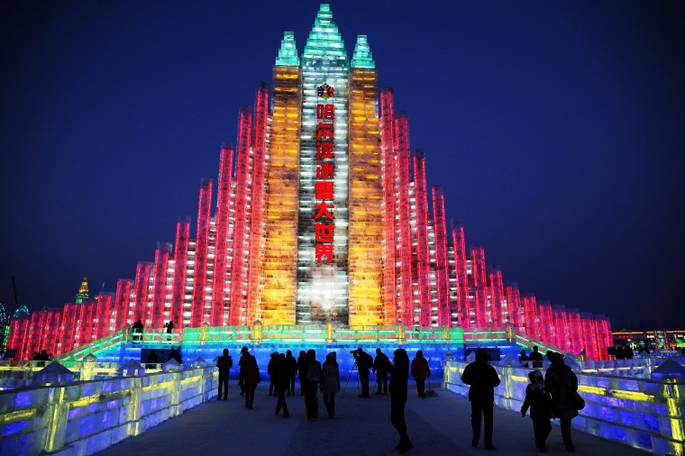 Tourists visit the ice buildings on display at the Ice and Snow World during the Harbin International Ice & Snow Sculpture Festival on January 5, 2014 in Harbin, China. (Lintao Zhang/Getty Images)