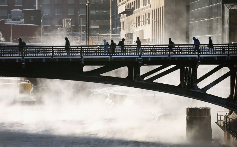 Commuters make their way across the Chicago River during a sub-zero trek to their offices in the Loop. (Photo by Scott Olson/Getty Images)