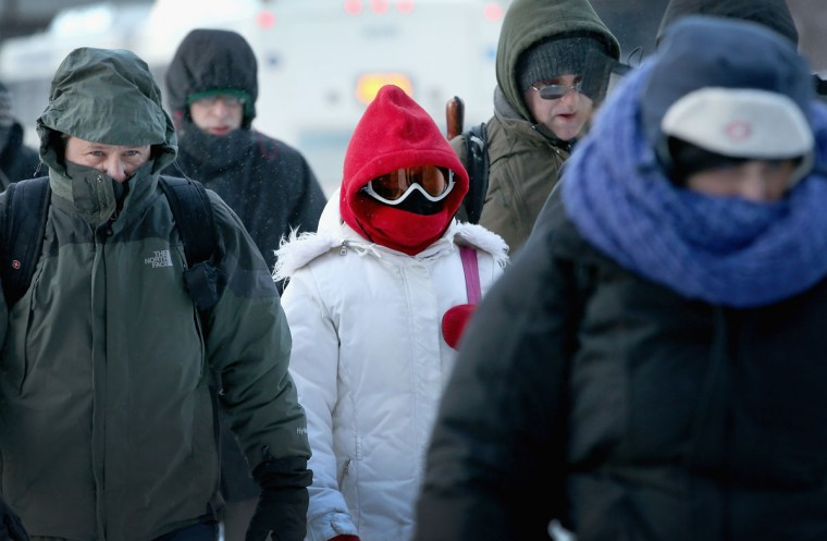 Commuters make a sub-zero trek to offices in the Loop on January 6, 2014 in Chicago. Temperatures in the city dipped to -16 degrees Fahrenheit. (Photo by Scott Olson/Getty Images)
