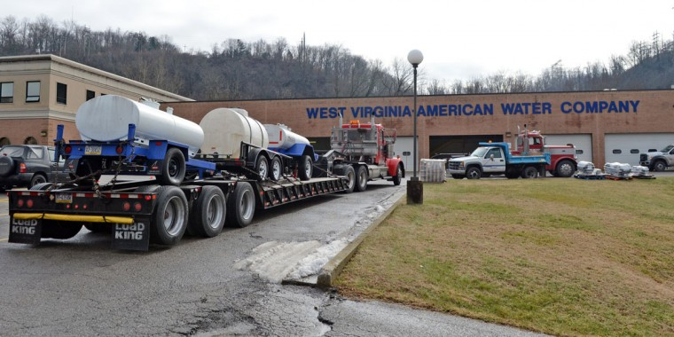 """Known as 'buffalos', water tanks from Northern PA were arrive at a steady pace at West Virginia American Water on January 10, 2014 in Charleston, West Virginia. West Virginia American Water determined Thursday MCHM chemical had """"overwhelmed"""" the plant's capacity to keep it out of the water from a spill at Freedom Industries in Charleston. An unknown amount of the hazardous chemical contaminated the public water system for potentially 300,000 people in West Virginia. (Tom Hindman/Getty Images)"""