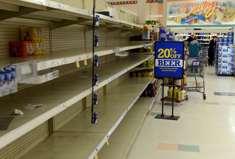 """Shelves at Krogers remain empty after running out of water in Kanawha City a neighborhood of Charleston on January 10, 2014 in Charleston, West Virginia. West Virginia American Water determined Thursday MCHM chemical had """"overwhelmed"""" the plant's capacity to keep it out of the water from a spill at Freedom Industries in Charleston. An unknown amount of the hazardous chemical contaminated the public water system for potentially 300,000 people in West Virginia. (Tom Hindman/Getty Images)"""