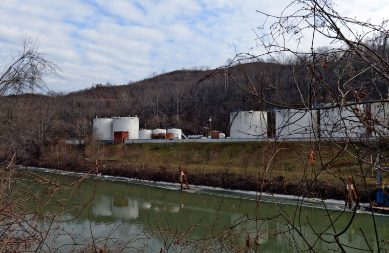 "Freedom Industries on Barlow St on the banks of the Elk River is seen on January 10, 2014 in Charleston, West Virginia. West Virginia American Water determined Thursday MCHM chemical had ""overwhelmed"" the plant's capacity to keep it out of the water from a spill at Freedom Industries in Charleston. An unknown amount of the hazardous chemical contaminated the public water system for potentially 300,000 people in West Virginia. (Tom Hindman/Getty Images)"