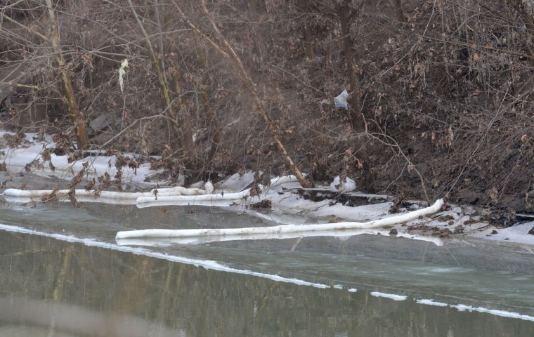 """The banks of the Elk River, where Kanawha County emergency services eventually determined the chemical had seeped through a secondary containment barrier, is seen on January 10, 2014 in Charleston, West Virginia. West Virginia American Water determined Thursday MCHM chemical had """"overwhelmed"""" the plant's capacity to keep it out of the water from a spill at Freedom Industries in Charleston. An unknown amount of the hazardous chemical contaminated the public water system for potentially 300,000 people in West Virginia. (Tom Hindman/Getty Images)"""