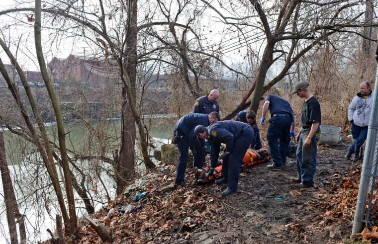 """Charleston Paramedics & First Responders responded to a man unresponsive on the banks of the Elk River on January 10, 2014 in Charleston, West Virginia. Authorities first thought it might be related to the chemical leak. West Virginia American Water determined Thursday MCHM chemical had """"overwhelmed"""" the plant's capacity to keep it out of the water from a spill at Freedom Industries in Charleston. An unknown amount of the hazardous chemical contaminated the public water system for potentially 300,000 people in West Virginia. (Tom Hindman/Getty Images)"""