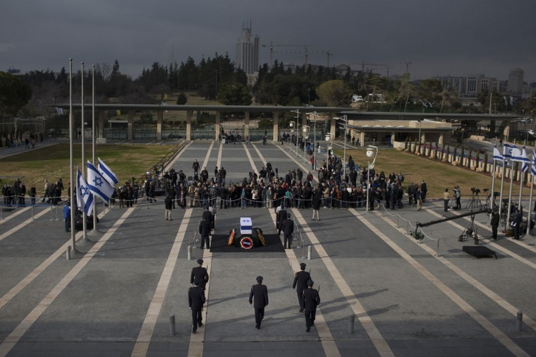 People gather as former Israeli Prime Minister Ariel Sharon lies in state at Knesset Plaza on January 12, 2014 in Jerusalem. (Uriel Sinai/Getty Images)