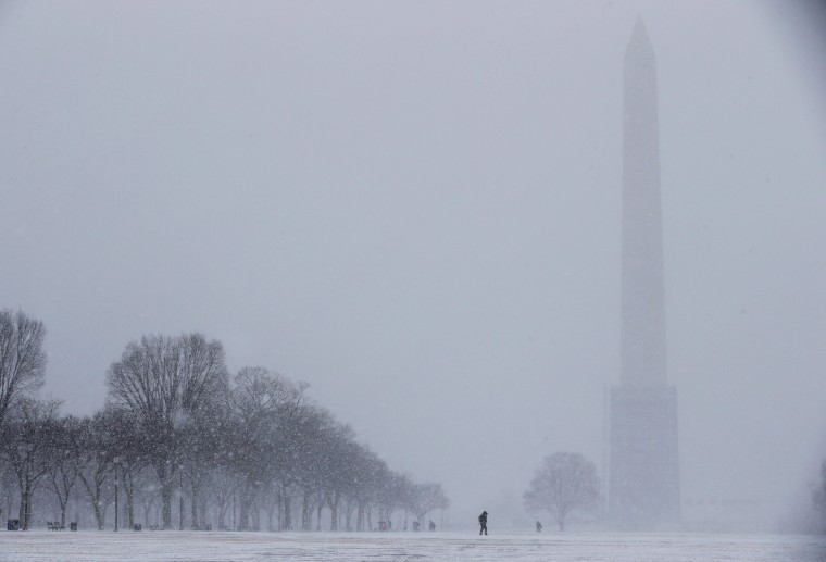 The Washington Monument fades into blowing snow on the National Mall January 21, 2014 in Washington, DC. A strong winter storm is bearing down on the East Coast between Virginia and Massachusetts and could dump four to eight inches of snow on the Washington area. (Photo by Chip Somodevilla/Getty Images)