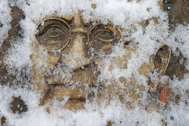 Snow obscures a relief sculpture of Ghandi near the White House January 21, 2014 in Washington, DC. A strong winter storm is bearing down on the East Coast between Virginia and Massachusetts and could dump four to eight inches of snow on the Washington area. (Photo by Chip Somodevilla/Getty Images)