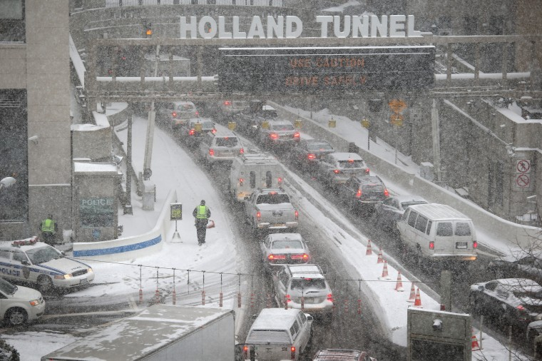Traffic moves slowly through the snow into the Holland Tunnel from Manhattan during a snowstorm on January 21, 2014 in New York City. Areas of the Northeast are predicted to receive up to a foot of snow in what may be the biggest snowfall of the season so far. (Photo by John Moore/Getty Images)