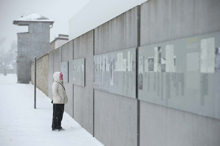 A visitor reads an exhibit plaque at the Sachsenhausen concentration camp memorial on Holocaust Memorial Day on January 27, 2014 in Oranienburg, Germany. Sachsenhausen operated from 1933 until 1945 as a concentration camp run by the Nazis where political opponents, Jews and Soviet prisoners of war were imprisoned and many of them murdered. Germany is commemorating the Holocaust today with a variety of events across the country. (Sean Gallup/Getty Images)