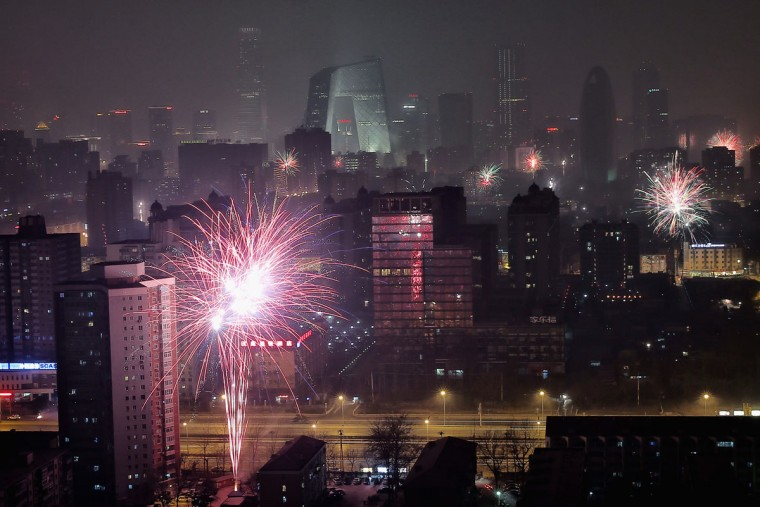 Fireworks illuminate the skyline to celebrate Chinese Lunar New Year of Horse and cause severe air pollution on January 30, 2014 in Beijing, China. The Chinese Lunar New Year of Horse also known as the Spring Festival, which is based on the Lunisolar Chinese calendar, is celebrated from the first day of the first month of the lunar year and ends with Lantern Festival on the Fifteenth day. (Photo by Feng Li/Getty Images)