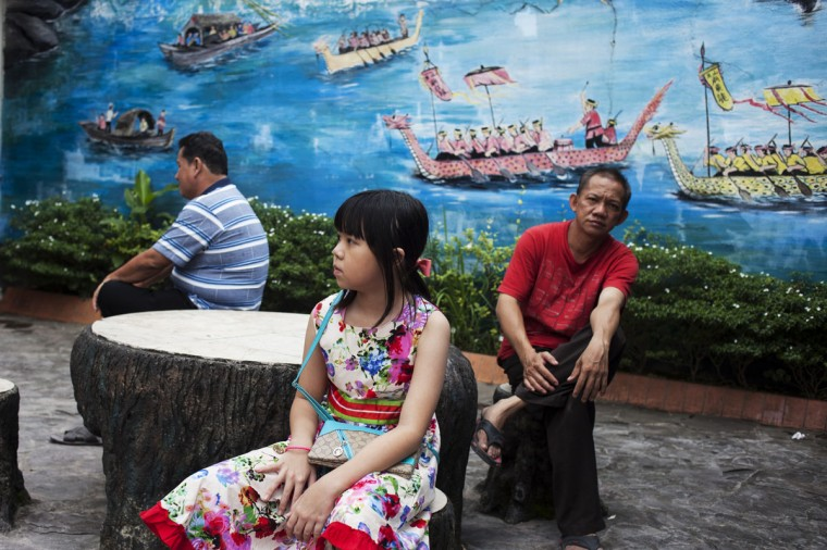 People take a rest at a park during Chinese New Year celebrations for the Year of The Horse at Bun San Bio Temple on January 31, 2014 in Tangerang, Indonesia. Indonesian Chinese today are celebrating the Chinese New Year and welcoming the Year of the Horse, with new year's day falling on January 31st. Chinese new Year is the most important festival in the Chinese calendar and is widely celebrated across Asia. (Photo by Oscar Siagian/Getty Images)