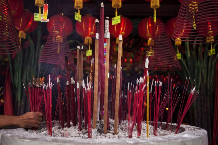 Incense sticks are placed during Chinese New Year celebrations for the Year of The Horse at Bun San Bio Temple on January 31, 2014 in Tangerang, Indonesia. Indonesian Chinese today are celebrating the Chinese New Year and welcoming the Year of the Horse, with new year's day falling on January 31st. Chinese new Year is the most important festival in the Chinese calendar and is widely celebrated across Asia. (Photo by Oscar Siagian/Getty Images)