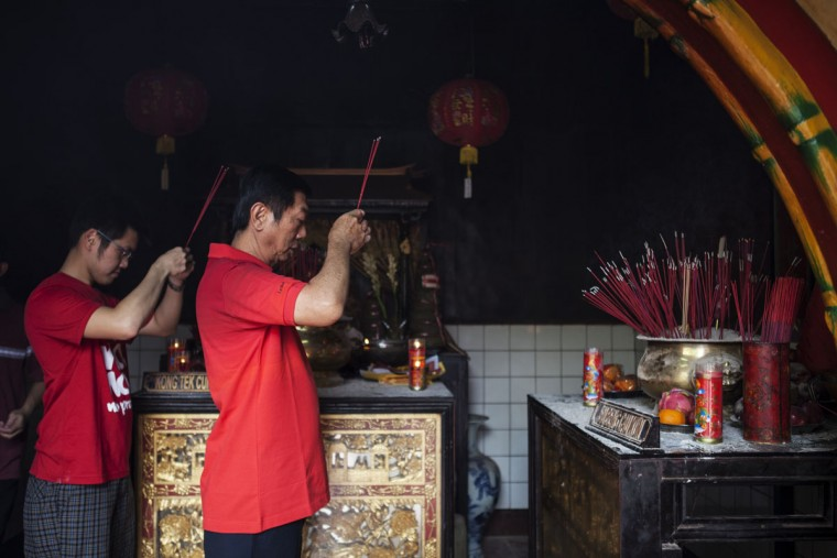 People hold incense sticks as they attend prayers during Chinese New Year celebrations for the Year of The Horse at Boen Tek Bio Temple on January 31, 2014 in Tangerang, Indonesia. Indonesian chinese celebrate the Chinese New Year today and welcome the Year of the Horse, with new year's day falling on January 31st. Chinese new Year is the most important festival in the Chinese calendar and is widely celebrated across Asia. (Photo by Oscar Siagian/Getty Images)
