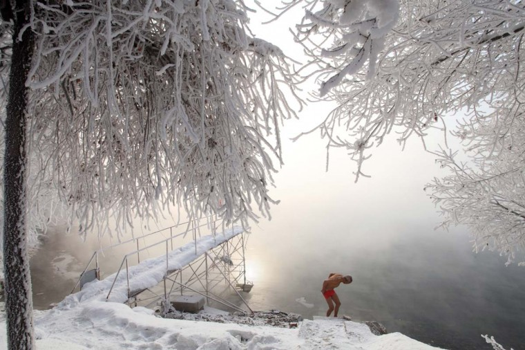 This picture taken on January 17, 2013 shows 77-year-old retired teacher Gao Yinyu preparing to go for a swim in the nude at a snow-covered bathing spot in Jilin, in northeastern China's Jilin province, in a temperature of minus 25 degrees Celsius. Gao has been exercising in only his underwear every morning for more than the past decade and has rarely caught cold ever since retirement. (AFP/Getty Images)
