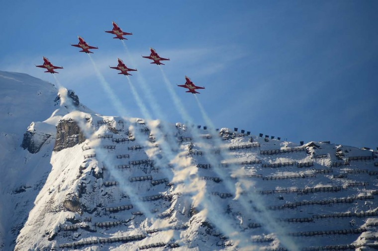 F5 Tiger fighter jets of the Swiss Air Force fly before the Men's Combined race at the FIS Alpine Skiing World Cup in Wengen on January 18, 2013. (Oliver Morin/AFP/Getty Images)
