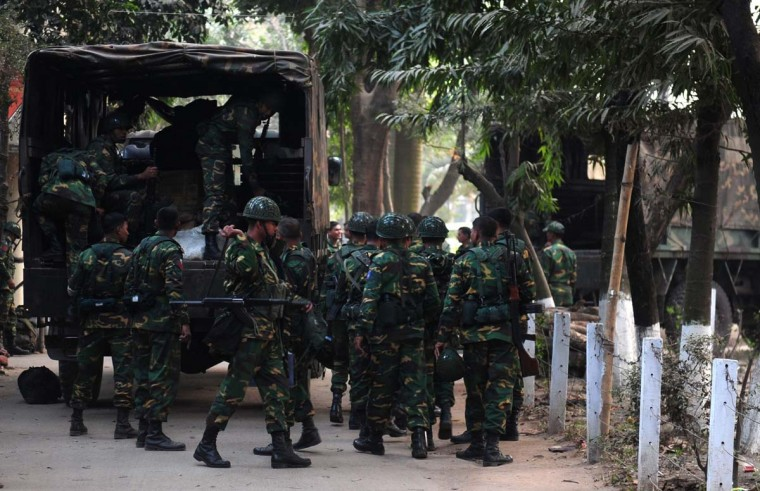 Army set to pull out: Bangladesh army personnel prepare their camp in Dhaka on December 26, 2013. The armed forces have commenced their deployment on election duty until January 9, 2014, to assist the country's law enforcement agencies to keep law and order for the 10th parliamentary polls scheduled for January 5. (MUNIR UZ ZAMAN/AFP/Getty Images)