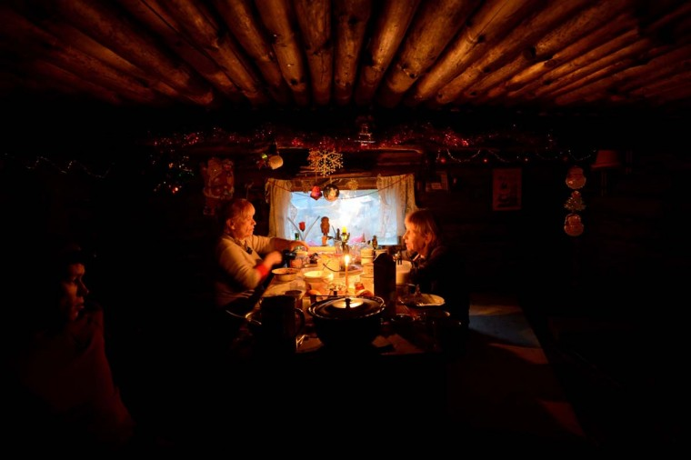 Orthodox Christmas: People celebrate the New Year in a house in the forest near the Sosnovo village, about 100 km of Saint-Petersburg on January 1, 2014. New Year is the biggest holiday of the year in Russia, and is followed by the Orthodox Christmas on January 7. (KIRILL KUDRYAVTSEV/AFP/Getty Images)