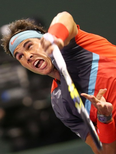 Spain's Rafael Nadal serves the ball to Germany's Tobias Kamke during their tennis match in Qatar's ExxonMobil Open in Doha on January 01, 2014. (Marwan Naam/AFP/Getty Images)
