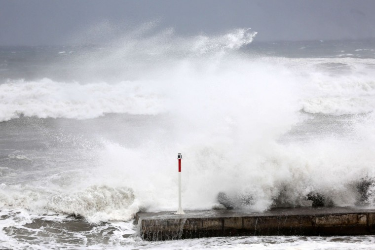 A cyclonic swell sweeps a pier on January 2, 2014, in la Possession, in the French La Reunion overseas island.The Indian Ocean island is placed on red-alert today, due to the proximity of the Bejisa hurricane with gusts between 120 and 150 km per hour and may even exceed 200 km per our on the reliefs exposed. (Richard Bouhet/AFP/Getty Images)