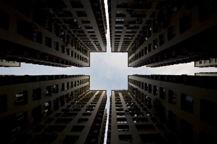 Apartment blocks form a symmetrical pattern in Hong Kong, on January 2, 2014. Home prices in the southern Chinese city have risen by 120 percent since 2008, and by more than 30 per cent from their previous peak in 1997, with prices in the luxury market being pushed up by wealthy buyers from mainland China. (Alex Ogle/AFP/Getty Images)