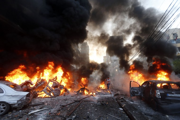 Flames rise from burning cars at the site of a car bomb that targeted Beirut's southern suburb of Haret Hreik on January 2, 2014. A large car bomb killed five people and wounded at least 20 in south Beirut, a health ministry source told AFP. (AFP/Getty Images)