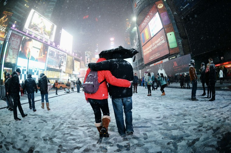 Visitors enjoy the snow on Broadway on January 2, 2014 on Times Square in New York. (DON EMMERT/AFP/Getty Images)