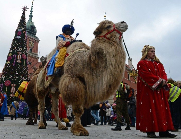A man dressed as one of the Three Magi sits on a camel during Epiphany celebrations in Warsaw's Old Town on January 6, 2014. During Epiphany holiday, the visit of the Three Magi to the infant Jesus is commemorated. (Janek Skarzynski/AFP/Getty Images)