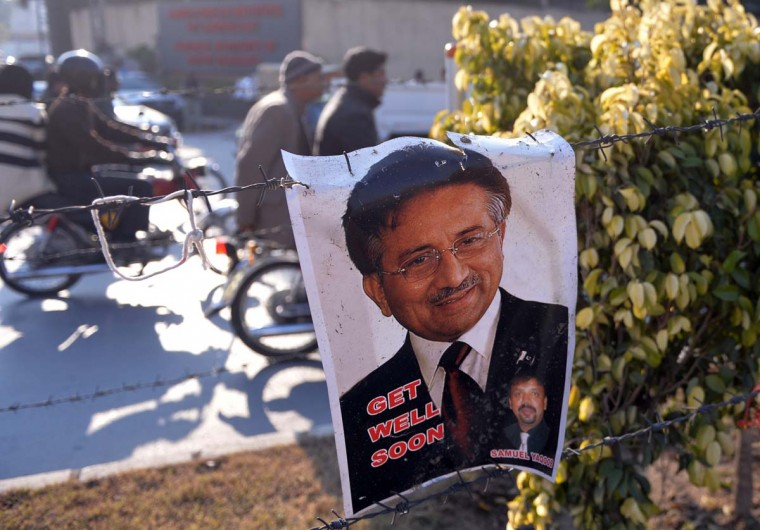 Musharraf to appear: A poster bearing the image of Pakistan's former military ruler Pervez Musharraf hangs on barbed wire in front of the Armed Forces Institute of Cardiology in Rawalpindi, where Musharraf is being treated. A court trying Pakistan's former military ruler Pervez Musharraf for treason on January 9 ordered him to appear in person on January 16, after considering a medical report on his heart complaint. The ruling grants the 70-year-old, currently in a military hospital, a week's respite in the case which has gripped the nuclear-armed nation for the past fortnight. (AAMIR QURESHI/AFP/Getty Images)
