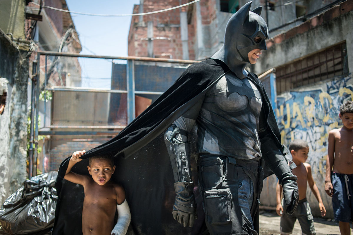 'Batman' visits Brazilian slum where residents homes are being expropriated for Maracana stadium reconstruction