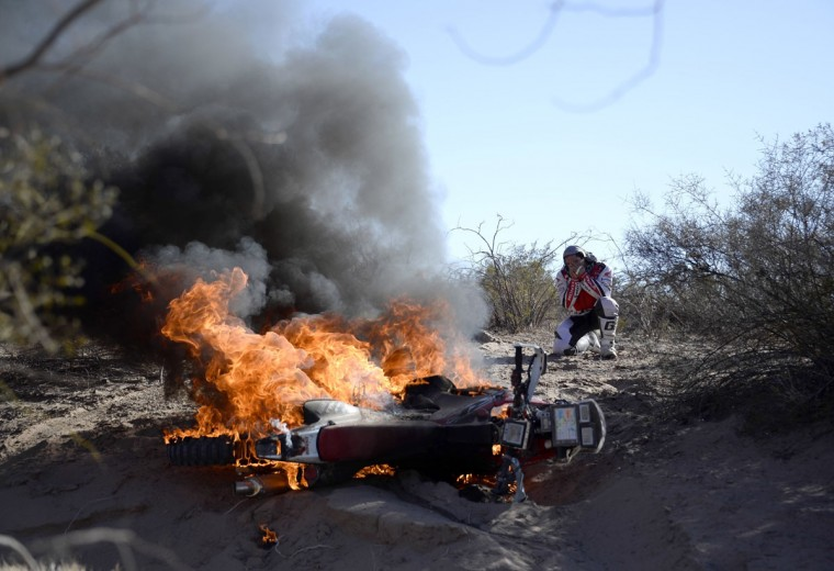Portuguese Paulo Goncalves watches his Honda on fire during the Stage 5 of the Dakar 2014 between Chilecito and Tucuman, Argentina, on January 9, 2014. (Franck Fief/AFP/Getty Images)