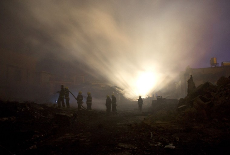 Firefighters put out a fire in the ancient Tibetan village of Dukezong in Shangri-La county, southwest China's Yunnan province on January 11, 2014. An ancient Tibetan village in the popular tourist area of Shangri-La in China's southwest Yunnan province has been partially destroyed in a giant inferno, state media reported. (China Out/AFP/Getty Images)