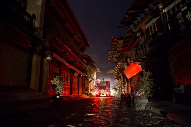 A fire truck arrives to put out a fire in the ancient Tibetan village of Dukezong in Shangri-La county, southwest China's Yunnan province on January 11, 2014. An ancient Tibetan village in the popular tourist area of Shangri-La in China's southwest Yunnan province has been partially destroyed in a giant inferno, state media reported. (China Out/AFP/Getty Images)