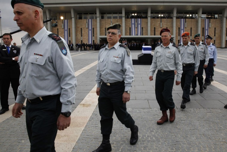 Israeli army generals pay their last respects as they march past the coffin of the late former prime minister Ariel Sharon, displayed at the Knesset (the Israeli Parliament) in Jerusalem on January 12, 2014. (Gali Tibbon/AFP/Getty Images)