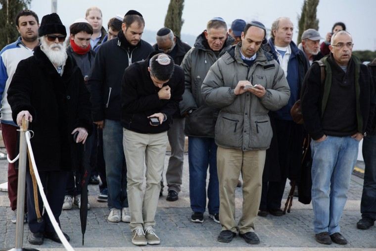 Israeli mourners pray as they pay their last respects next to former prime minister Ariel Sharon's coffin at the Knesset (the Israeli Parliament) in Jerusalem on January 12, 2014. (Gali Tibbon/AFP/Getty Images)