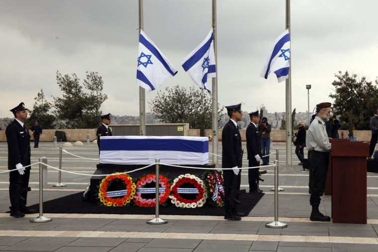 An Israeli honor guard stands next to the coffin of former prime minister Ariel Sharon at the Knesset (the Israeli Parliament) in Jerusalem on January 12, 2014. Israelis are paying their respects to Ariel Sharon, whose controversial life inspired admiration and provoked revulsion, and whose death drew emotional reactions even after he spent eight years in a coma. (Gali Tibbon/AFP/Getty Images)