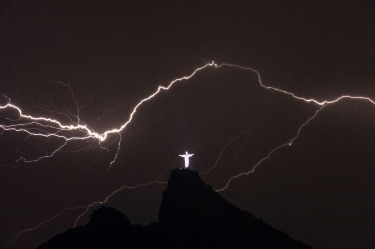 Lightning flashes over the Christ the Redeemer statue on top of Corcovado Hill in Rio de Janeiro on January 14, 2014. (Yasuyoshi Chiba/AFP/Getty Images)