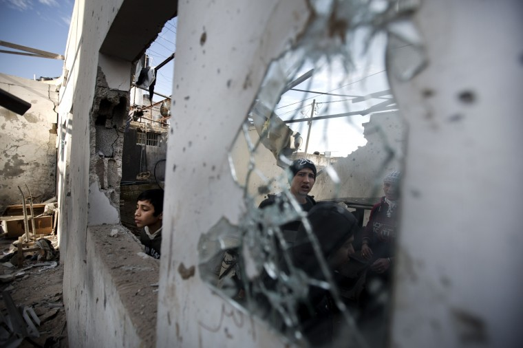 Palestinian youths check a destroyed building following overnight Israeli air strikes in Gaza City on January 16, 2014. Israeli air strikes in the Gaza Strip against training camps used by the armed wing of the territory's Hamas rulers left four children and a woman wounded, Palestinian medical sources said. (Mohammed Abed/AFP/Getty Images)