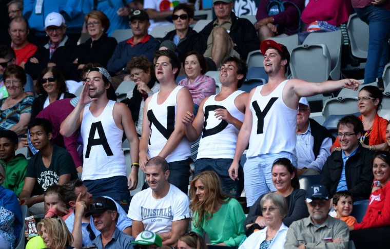 Fans of Britain's Andy Murray cheer during his men's singles match against Stephane Robert of France on day eight of the 2014 Australian Open tennis tournament in Melbourne. (WILLIAM WEST/AFP/Getty Images)