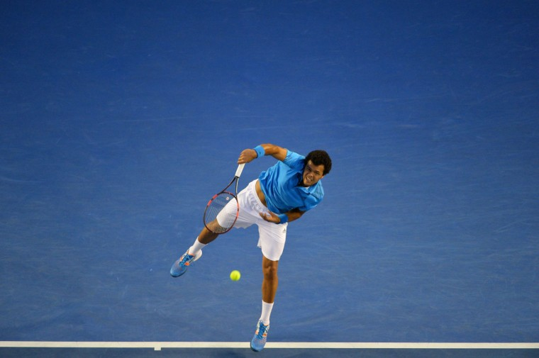 France's Jo-Wilfried Tsonga serves during his men's singles match against Switzerland's Roger Federer on day eight of the 2014 Australian Open tennis tournament in Melbourne. (SAEED KHAN/AFP/Getty Images)