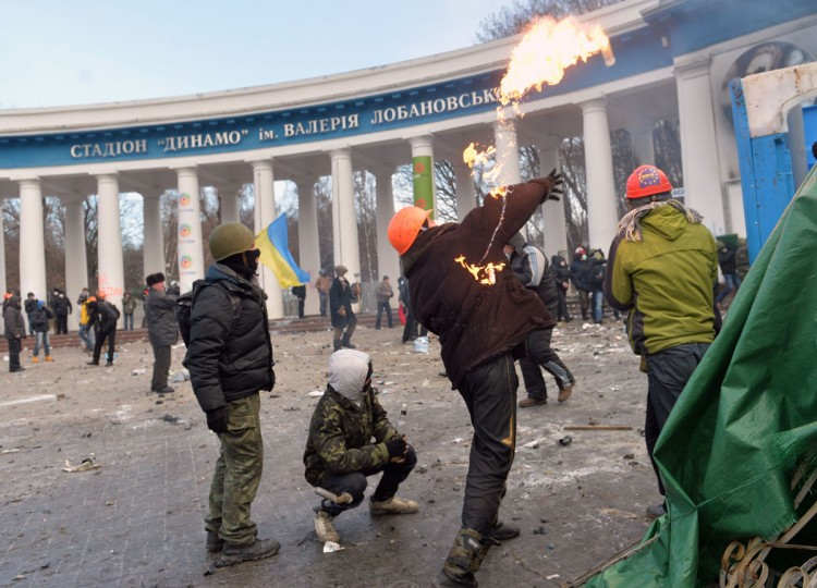 Protesters throw Molotov cocktails during clashes with the police in the centre of Kiev on January 20, 2014. (SERGEI SUPINSKY/AFP/Getty Images)